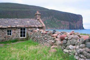 Stone cottage on beach at Hoy