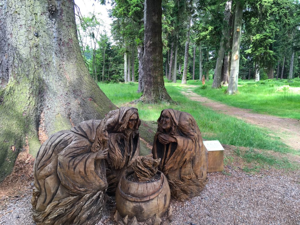 Wooden sculpture of the 3 witches from Macbeth