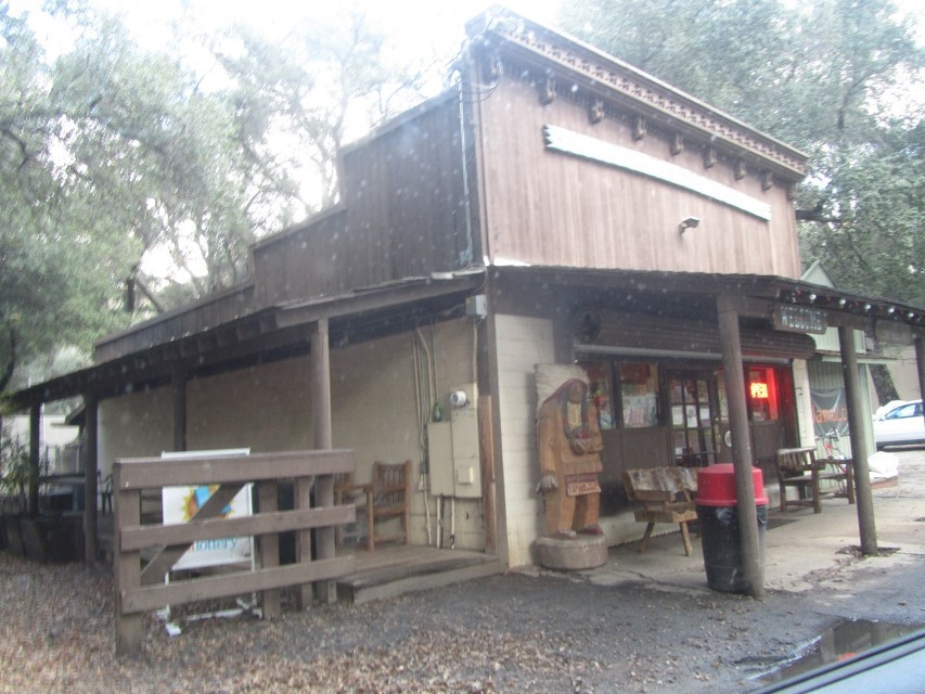 """We ran out of Milk, and went for a drive into the hills as a result of one our usual wrong turns.  """"The Jamul Country Store""""  and Geronimo, the Indian on the porch sold Athena a gallon of milk for $4.70. Almost as painful as being scalped. She said there was an old man and a woman discussing personal problems at the counter. Reminded her of the Olson store in Little House on the Prairie."""