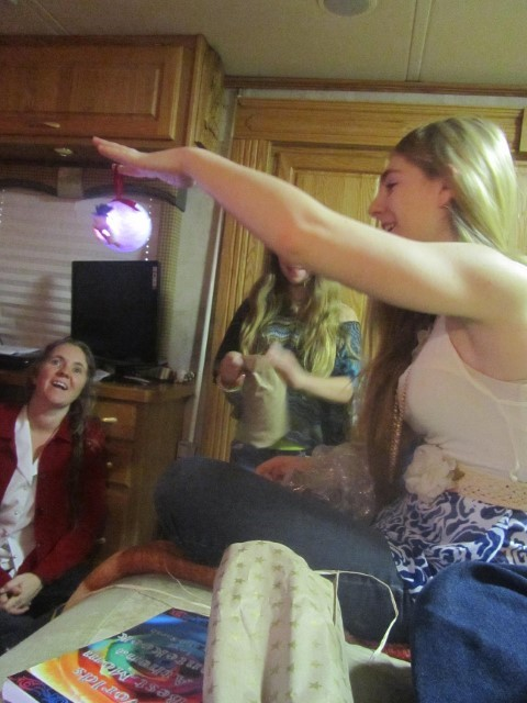 Emily gives Holly and Sarah Glowy Balls, they love them!