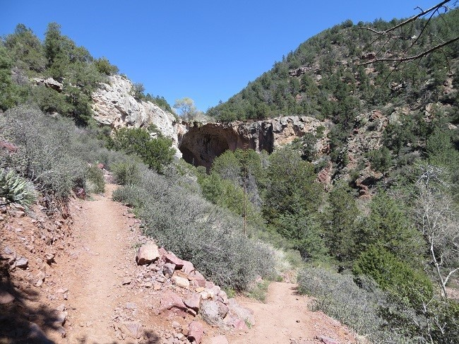 We see the cave in the distance. The trail is about half a mile long. Takes most people about 15 minute. Took Athena about an hour to drag me in, and at least that to drag me out! One trip down here, will be enough for me.
