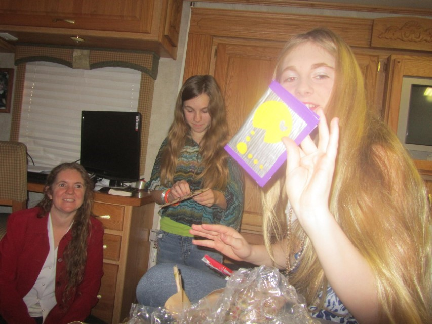 Holly and Sarah love the wallets Elizabeth made them.