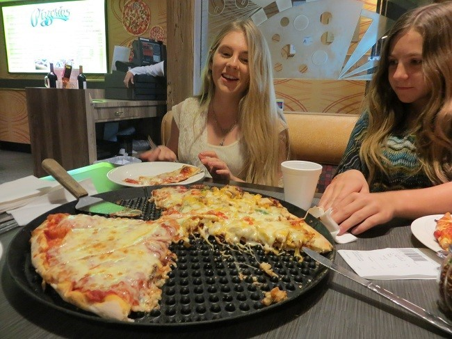 Speaking of puke, all that fun made us hungry.  $20.00 bought us enough pizza to feel like stuffed pigs. You can't get cheaper, quality food, than at the pizzeria in Circus Circus