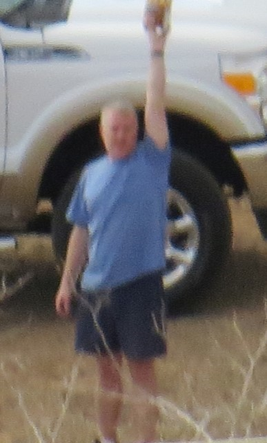 Had to put this picture in even though it is unclear.  The picture proves Steve is my best friend. He just arrived in his truck from the Metropolis of Page and returned with a half gallon of Rocky Road Ice Cream. He is trying to coax me down off the mountain with it.