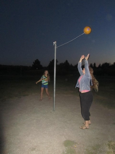 Athena and Sarah play tether ball at sunriver thousand trails.