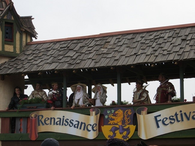 The king and a queen introduce us to the fair. The two nuns in center, I don't think they are really nuns. They give our young ladies some advice about  on how to deal with coming of age