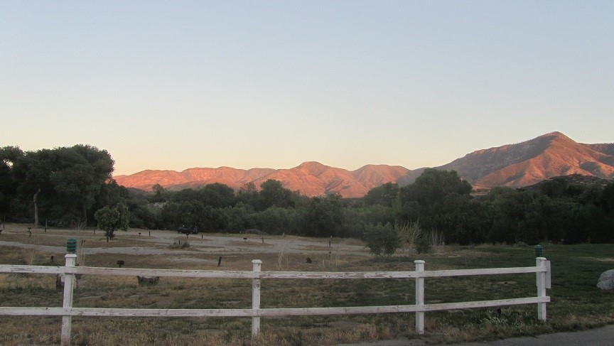 The sun is setting on the hills. That means the rattle snakes are coming out. We know this cause we saw one again.! Time to go home