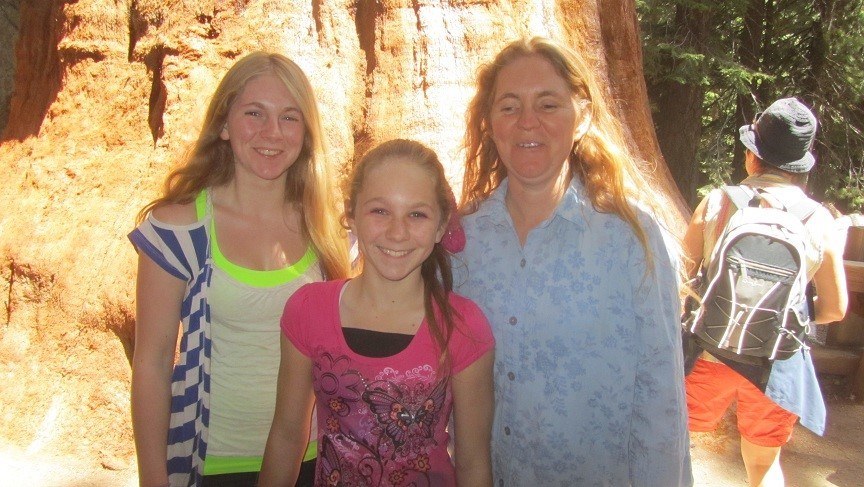 These people drug me down a really long trail (About 1/4 mile), but 1 hours walk each way. It took an hour because I am slightly heavy and hard to drag. We went to see the General Sherman tree. This is not it, but my family is mostly photgenic at this moment.