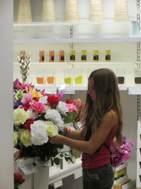 Learning how to arrange the floral department for dramatic effect