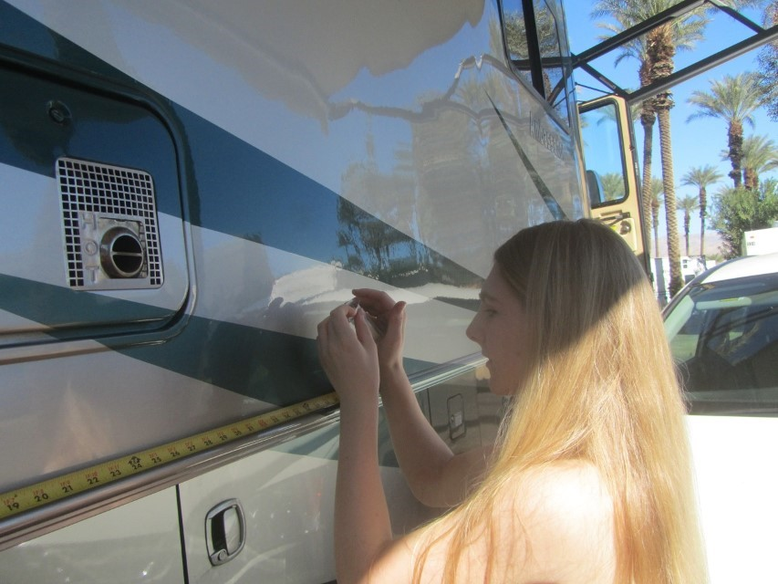 """Before we could leave for the Coachella Preserve and the Thousand Palms Oasis, Holly has to play with a tape measure. Her math class needs her to measure from two spots then figure the area and parameter of the side of the RV. I hope I never need this information my self. Should I need it, I am guessing """"Big Bill"""" will be following close behind."""