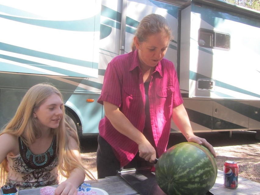 Athena cuts the watermelon for lunch