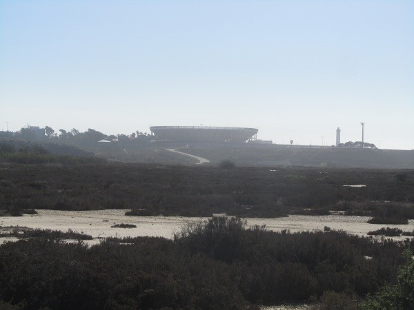 We get our first look at Tijuana, there is what looks like a large up side down bowl for processing the city's sewage, a light house, and some other buildings off in the haze.