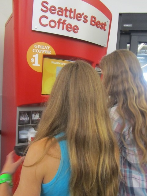 The thing takes credit cards! and serves hot chocolate too… The girls found it, and boy am I debt!
