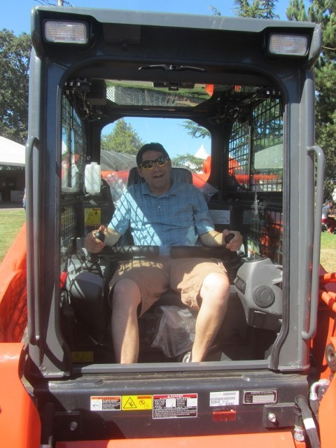 Mike's favorite ride at the fair is the scooper machine from Kubota.