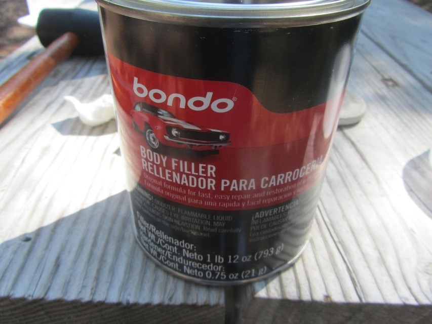 Wife pulls out the BONDO – Great product for filling indents. Not so good if the piece of work in punctured through. In that case one would have to weld material behind the hole, or in our case use glass matte and resin over the hole and sanded to blend.