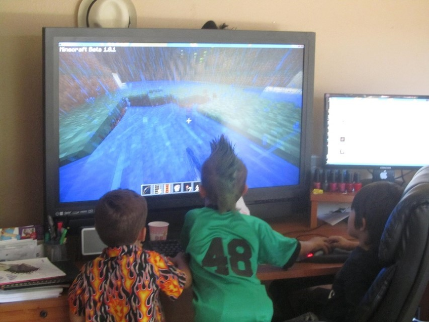 The boys however are having nothing of this female baby B-day thing. There are much better things to do in the world than hang out in a room full of pink stuff, and old people. Green Mohawks and video games are where its at.