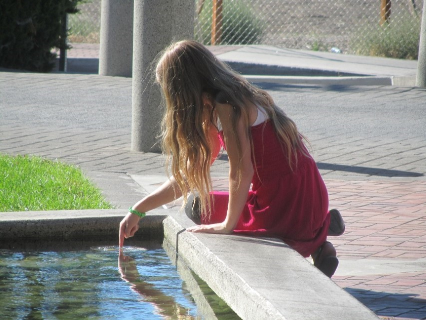 Sarah is pondering the water quality of the fountain