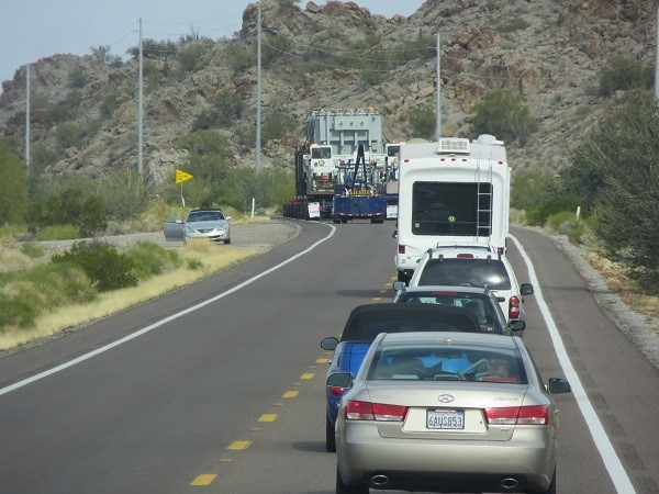 Travel Day again, headed to Lake Pleasant by Peoria, Az. Some really big object is in front of us, and is using all the road. One might want to always verify his bladder is empty before getting on the road!
