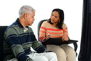 Older man and daughter reviewing resources