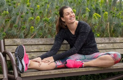 Anne Peled, M.D. a San Francisco Plastic Surgeon stretching on a park bench