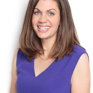 Headshot of Anne Peled, MD in purple top smiling