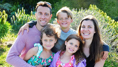 Anne Peled, MD with her husband Ziv Peled, MD and their three kids