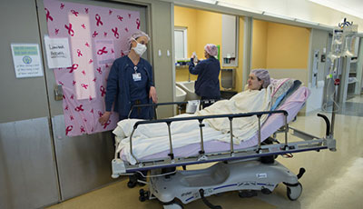 Anne Peled, MD in a gurney in the hospital