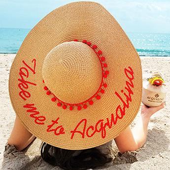 25-Acqualina-Hat-on-Beach