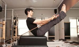 Pilates exercise: Teaser on the long box