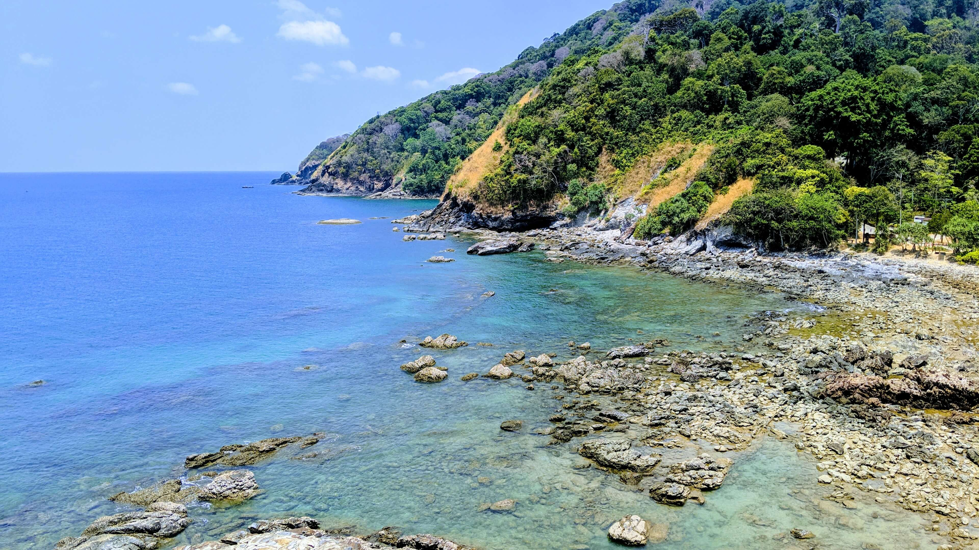 Mu Ko Lanta National Park - a cove of light blue and turquoise water.