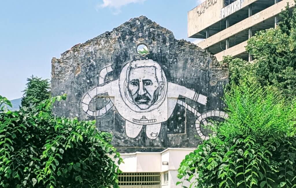 Street Art on an abandoned building of an astronaut in Mostar.