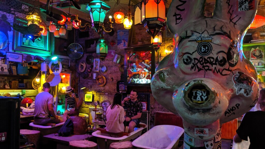 Funky Szimpla Ruins Pub - patrons drinking in bathtubs.  One of our favorite free things to see and do in Budapest.
