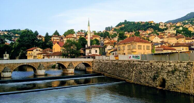 Sarajevo the heart of Bosnia and Herzegovina showing a bridge over the river with mosques in the background