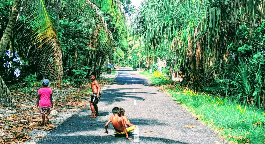 Kids playing on the only road on the Main Atoll