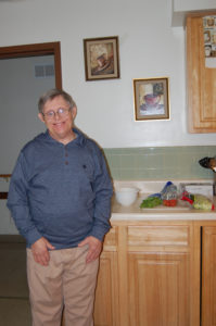 Man standing in his kitchen