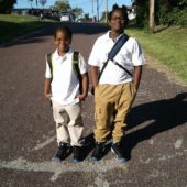 Two young students going back to school