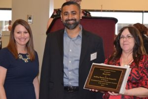 Bhavik Patel receiving award
