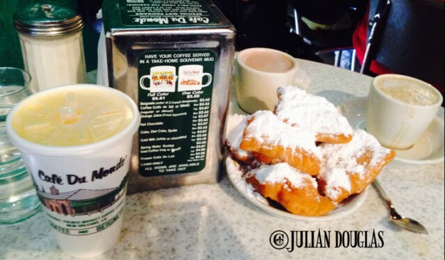 OUr table at Cafe Du Monde... Beignets, orange juics and chicory coffee & cafe au lait.