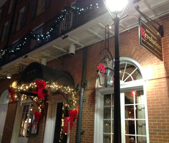 Restaurant R'evolution's Bienville Street entrance, all decked forthe Holidays (photo courtesy of Restaurant R'evolution).