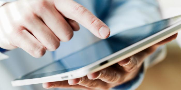 healthcare executive using iPad