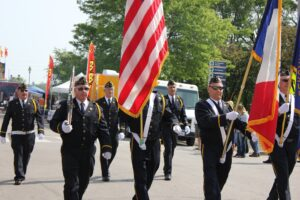Veterans parading with US Flag