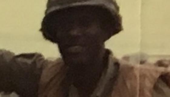 Adam Joseph Standing In Uniform - Featured Image