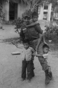 Image of Billy Terrell at Mang Lang Orphanage with Boys in 1966
