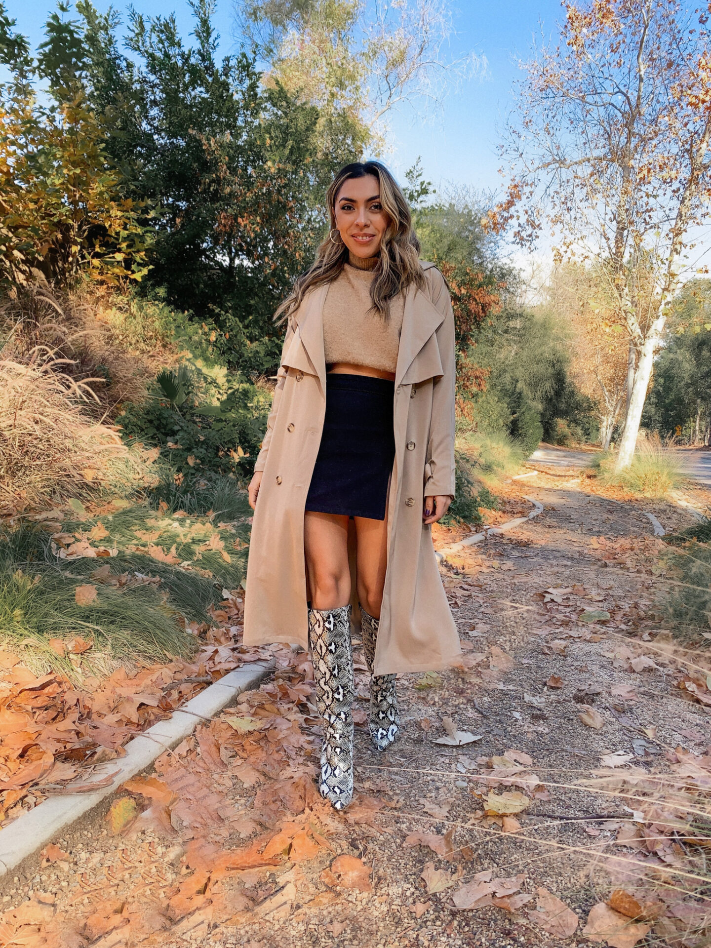 Alexis Alcala showing how you can wear a trench coat in 4 different ways.