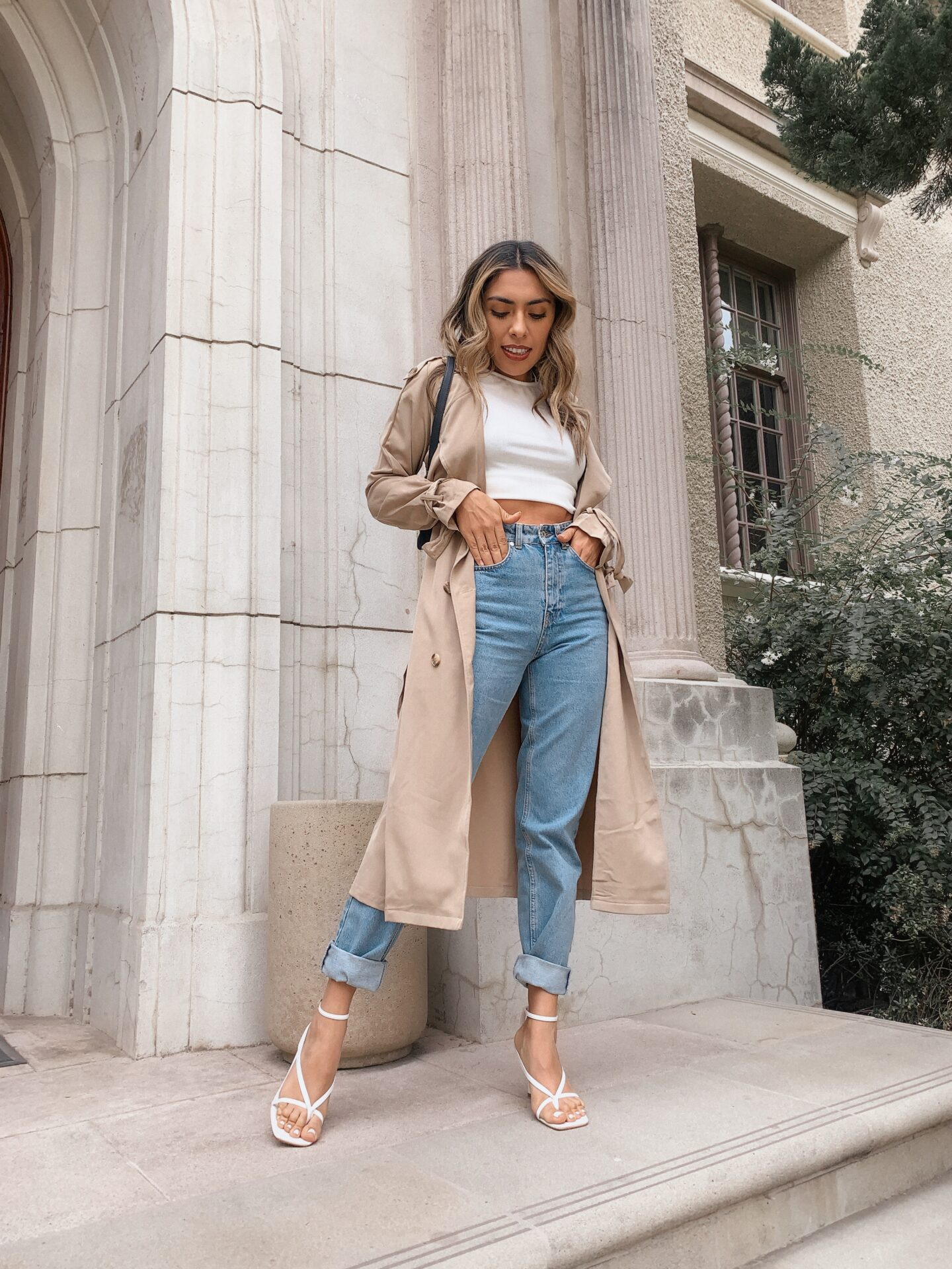 Alexis Alcala showing how you can wear a trench coat a classic peice in 4 different ways.