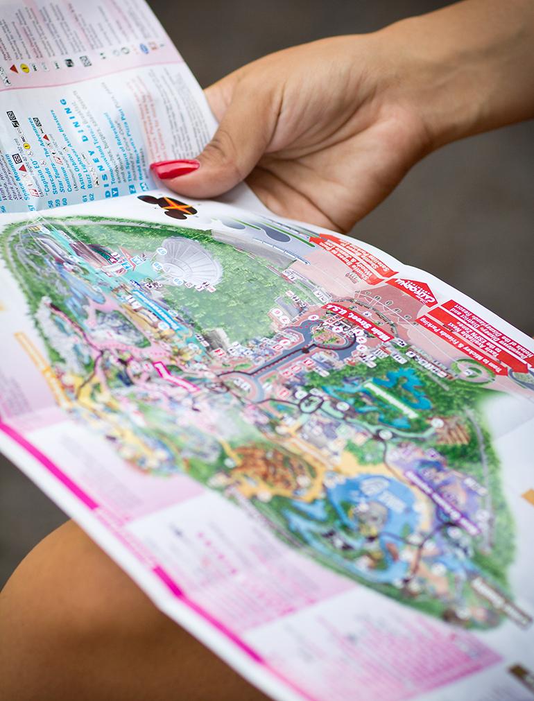 A Closeup of Alexis Alcala Examining a Map of Disneyland