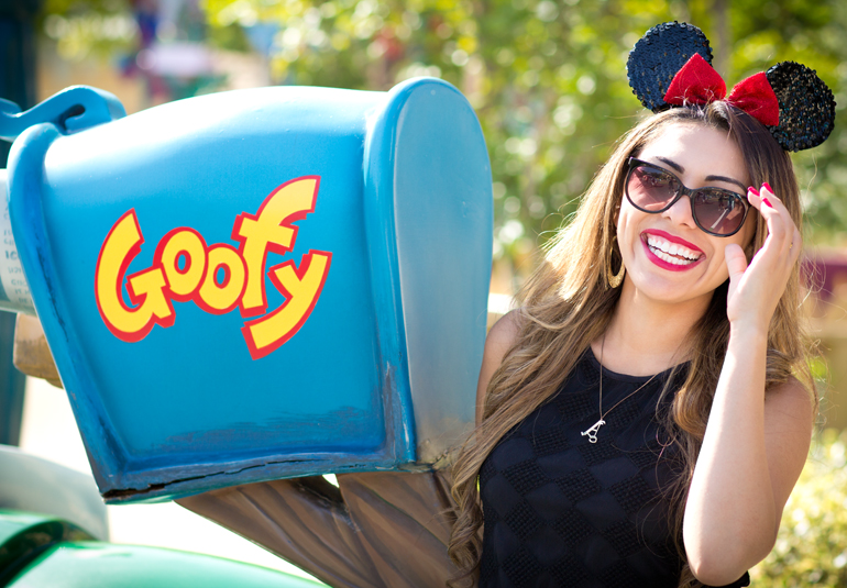 Alexis Alcala Laughing Next to Goofy's Mailbox in Toowntown at Disneyland