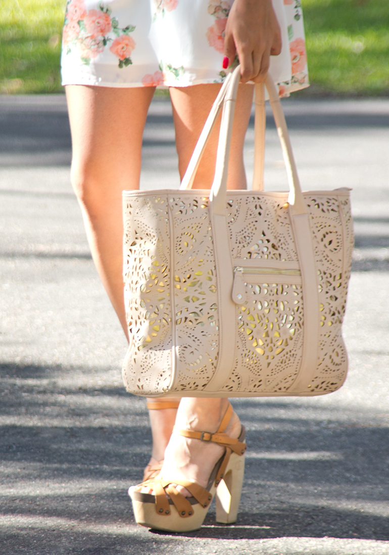Alexis Alcala Walking With a Large Tan Purse to Carry Her Favorite Beauty Supplies