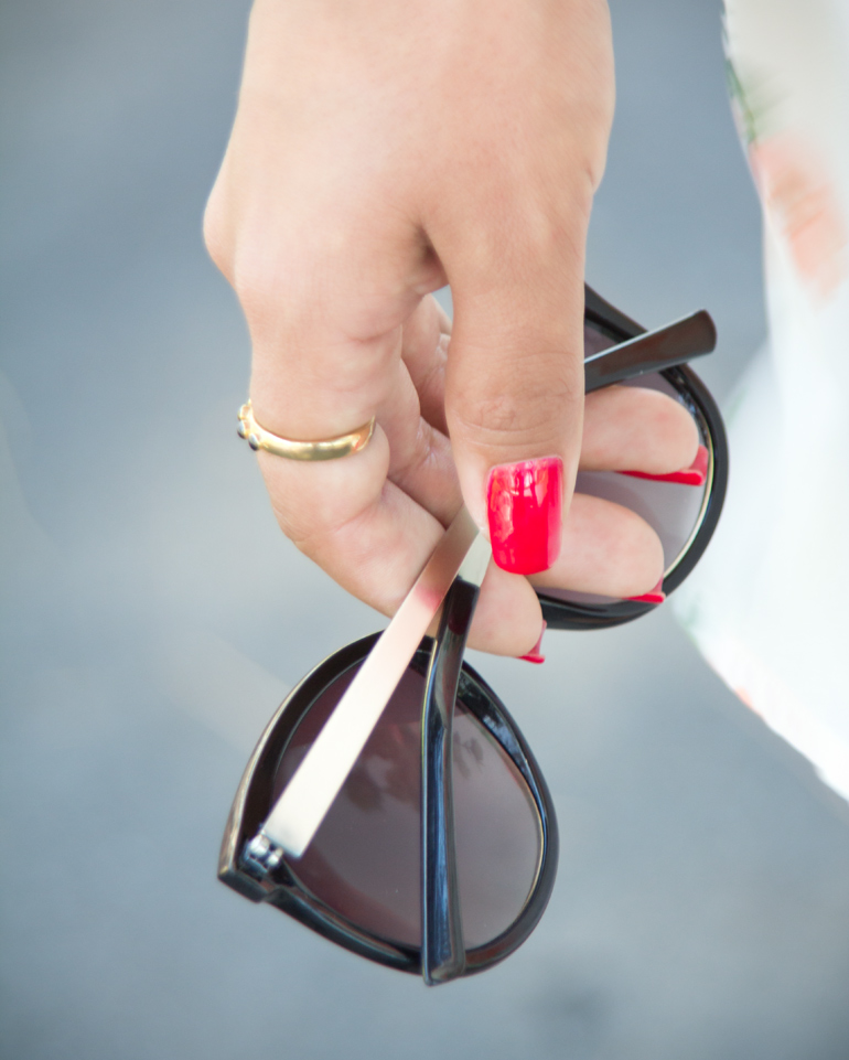A Closeup View of Alexis Alcala's Favorite Crystal Catty Round Sunglasses From Urban Outfitters