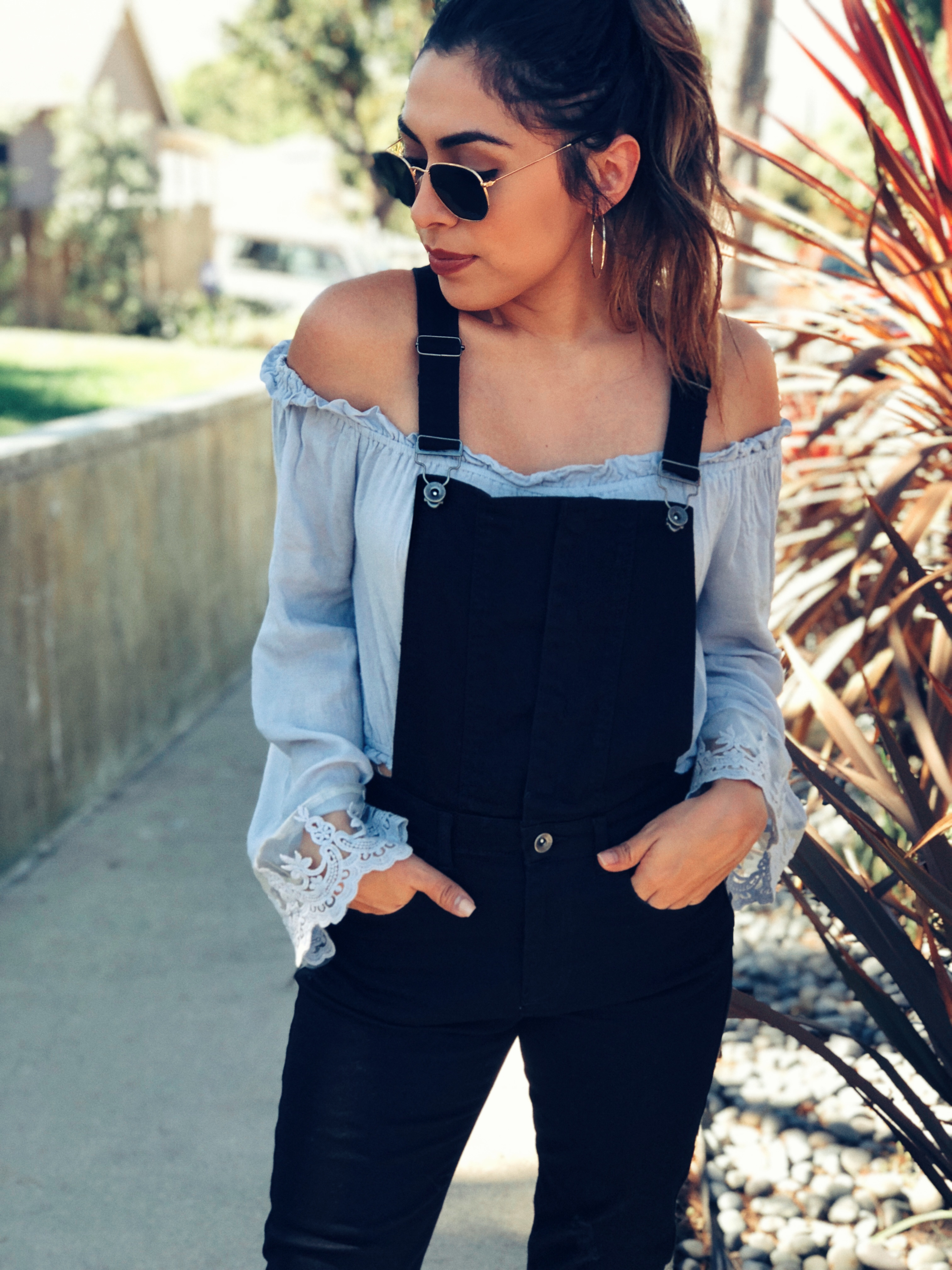 Fashion Blogger Alexis Alcala wearing Forever 21 overalls, Steve Madden boots and tobi off shoulder top during the fall